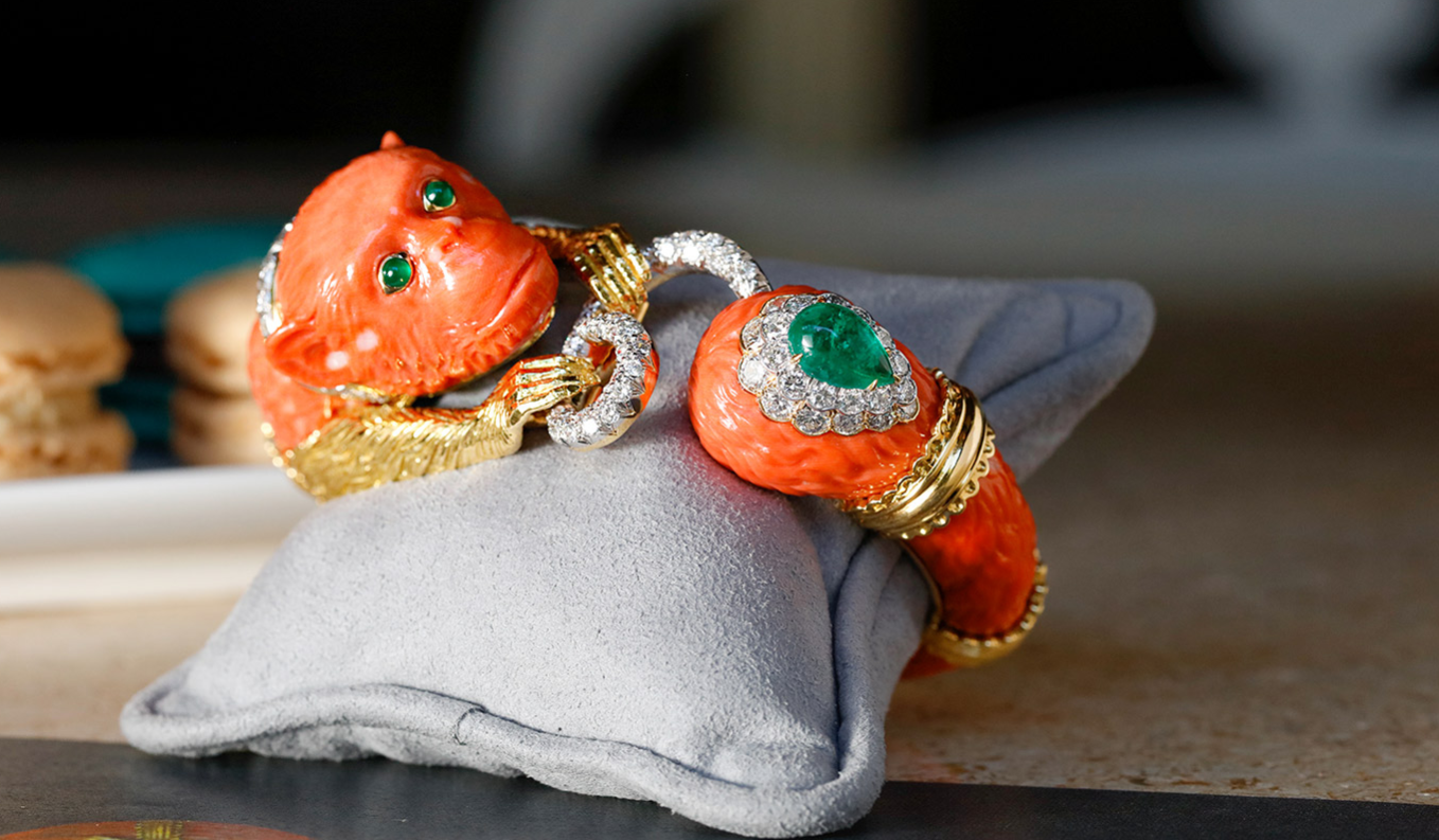 David Webb 'Monkey' bracelet with carved coral, cabochon emeralds and brilliant cut diamonds in 18k gold and platinum