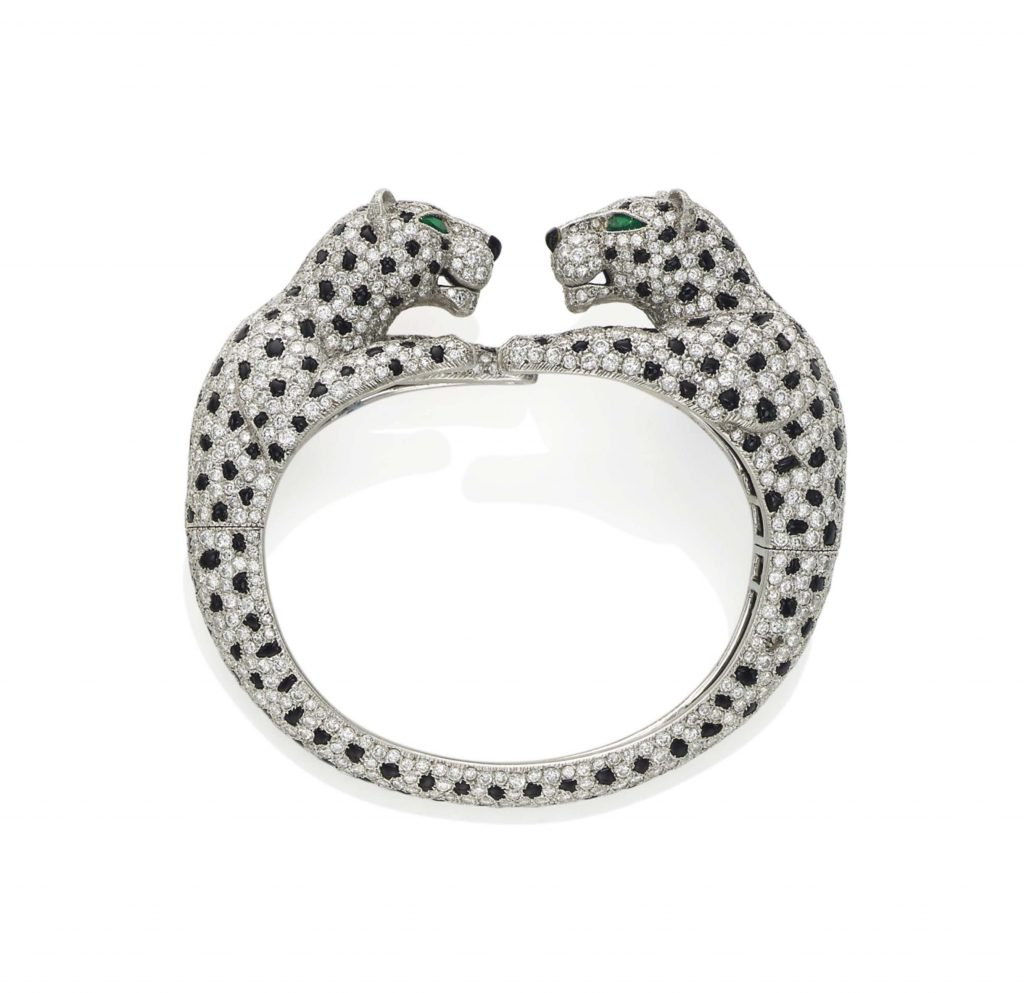 A CARTIER DIAMOND AND ONYX DOUBLE PANTHER HEAD BANGLE